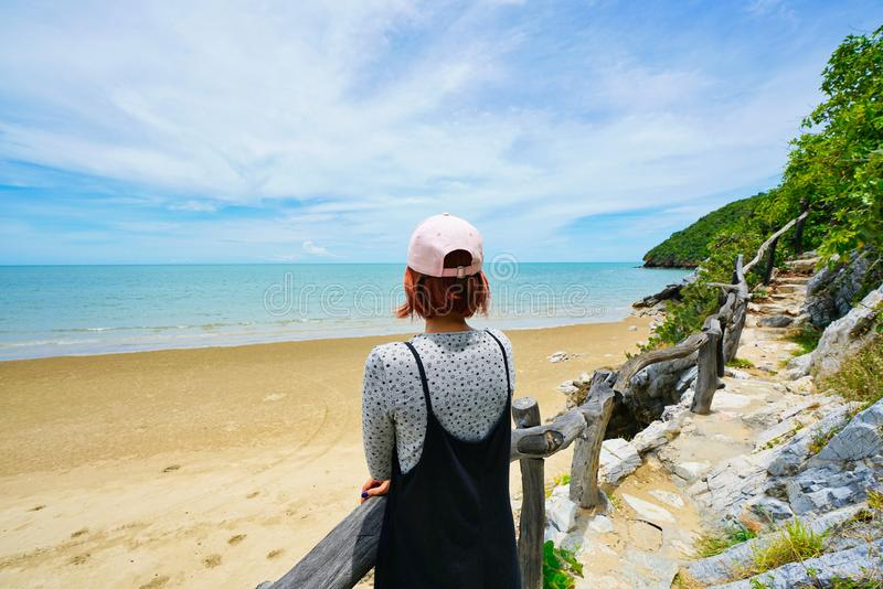 Thai lady overlooking the sea at the beach in Pran Buri, Thailand stock image