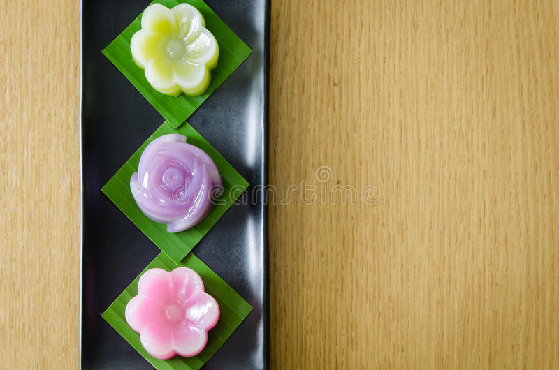 Thai Layer Sweet Cakes. Thai Sweet Food and Dessert Food, Freshly Homemade of Colorful Thai Layer Sweet Cakes in flower shape stock photos