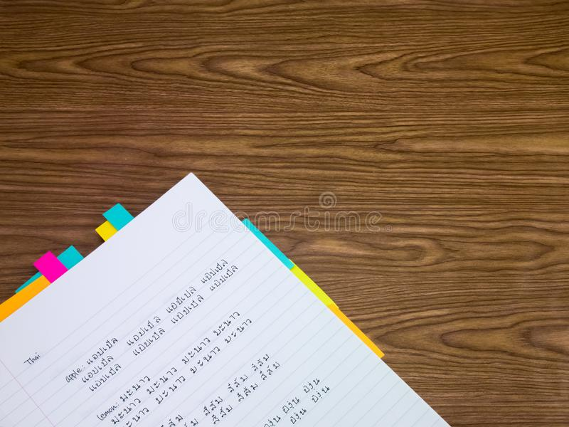 Thai; Learning New Language Writing Words on the Notebook royalty free stock images