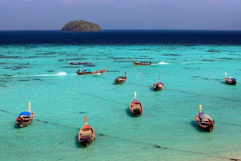 Thai local fishing boats on seaside at Lipe island beach. Of the Andaman sea, in Satun Province of Thailand stock photo