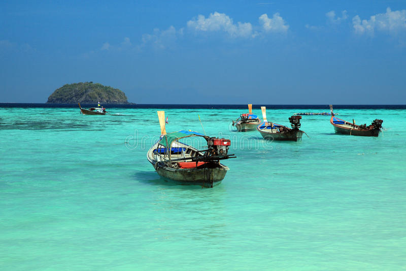 Thai local fishing boats on seaside at Lipe island beach. Of the Andaman sea, in Satun Province of Thailand royalty free stock images