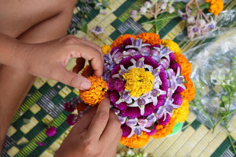 Thai Local people make flower bowl. stock photography