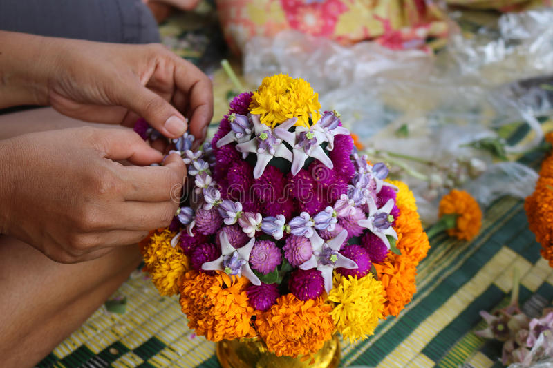 Thai Local people make flower bowl. stock image
