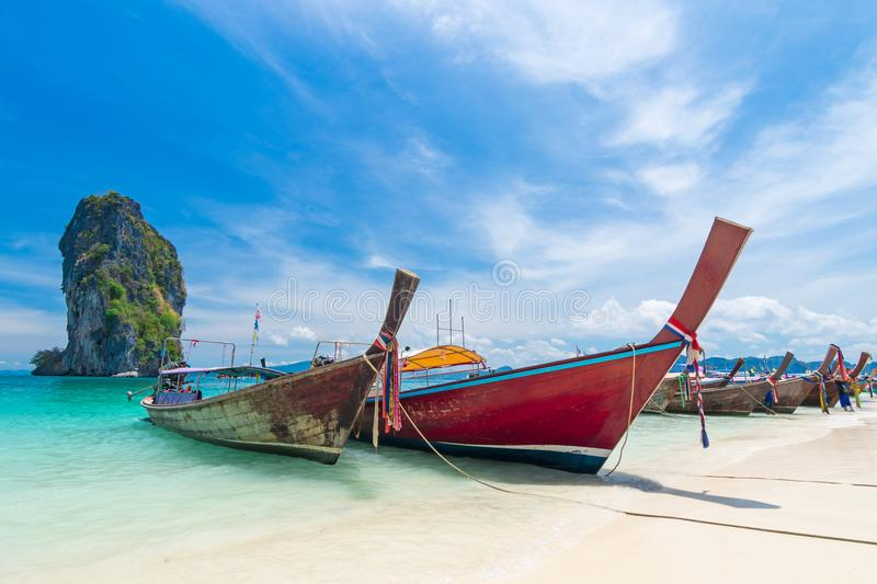 Thai long tail boats on the beach with beautiful island. Krabi Thailand stock photography