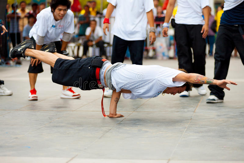 Thai Male Breakdancers One Handed Plank royalty free stock image