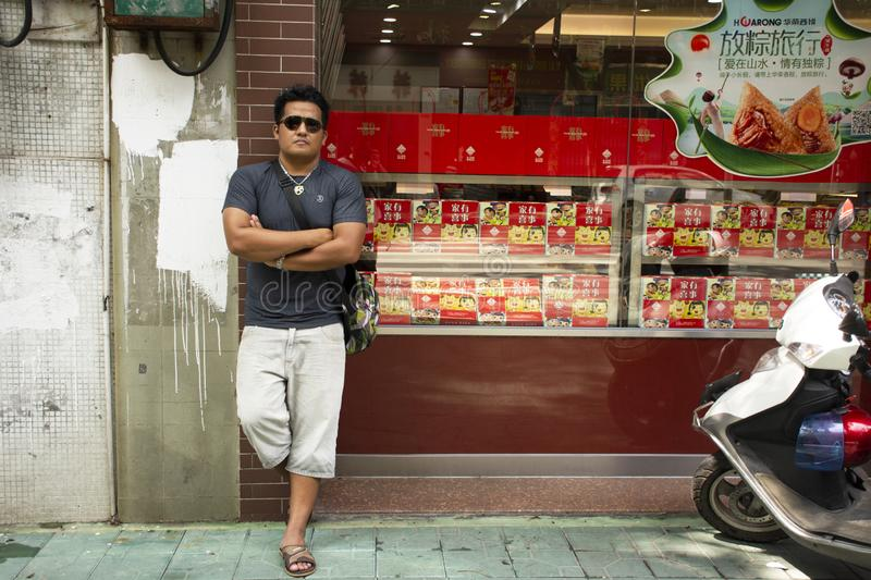 Thai man people travel visit and posing for take photo at sweet snack shop chinese style at Teochew city in Chaozhou, China. Thai man people travel visit and royalty free stock photo