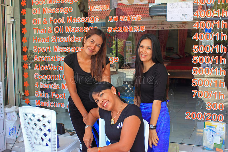 Thai massage girls, Kata beach, Phuket, Thailand stock photography
