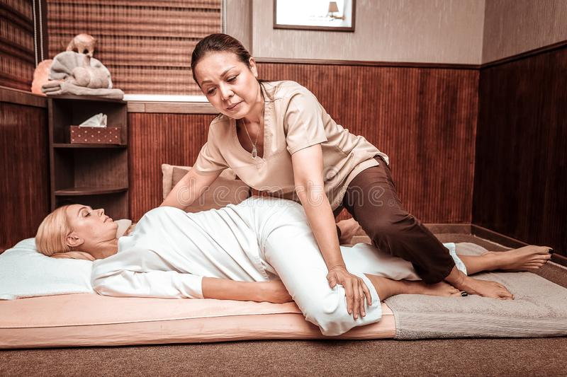 Thai massage session for relaxed blonde woman. royalty free stock photos