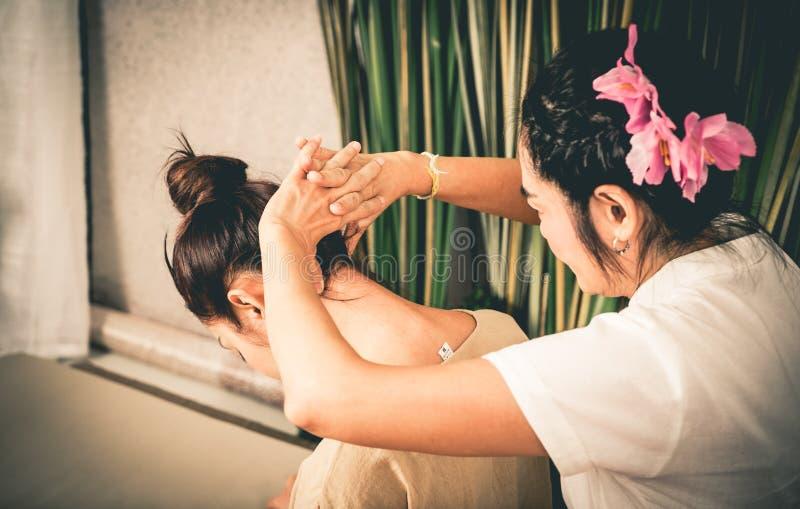 Thai Massage Therapist is massaging women neck. Thai Massage Therapist is massaging a women neck stock image