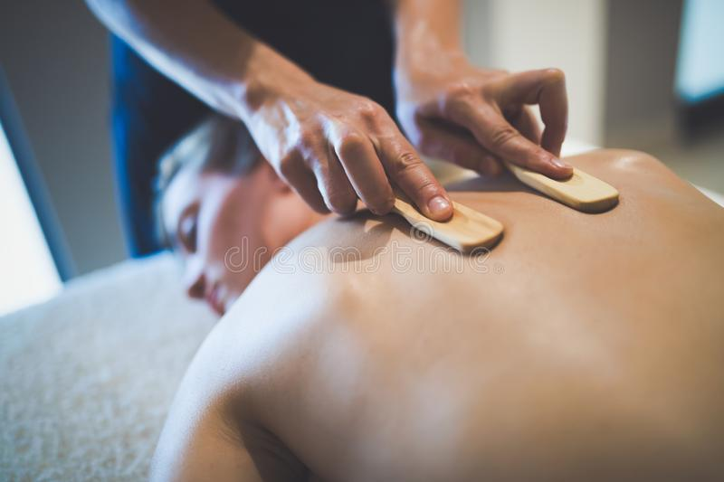 Thai massage therapist treating patient. At healthcare salon stock images