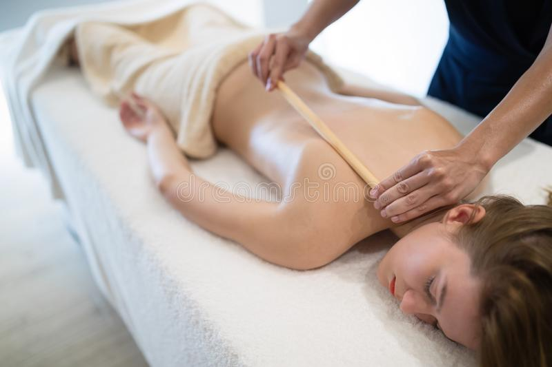 Thai massage therapist treating patient stock photo