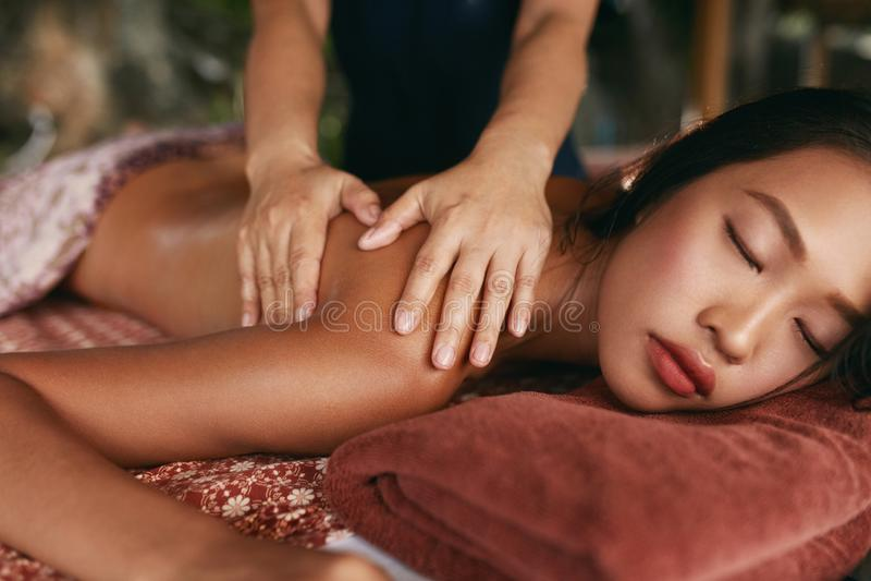 Thai Massage. Woman Having Relaxation Back Massage At Spa Salon stock photo
