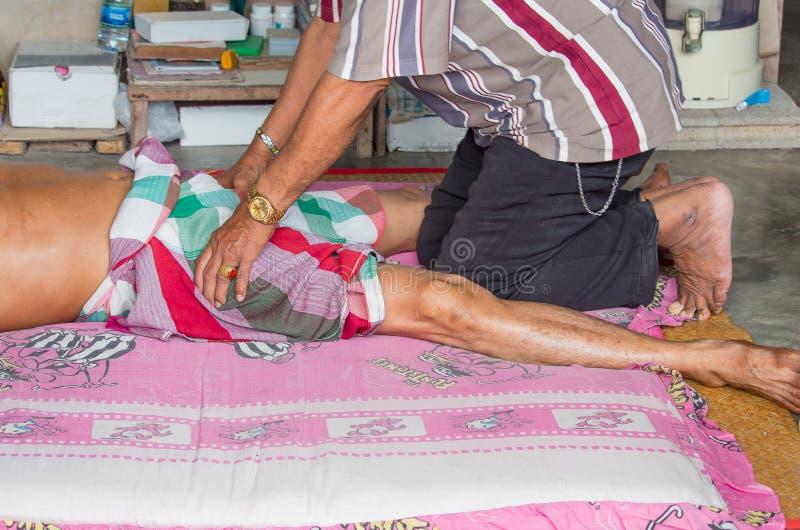 Thai massagist doing massage royalty free stock photo
