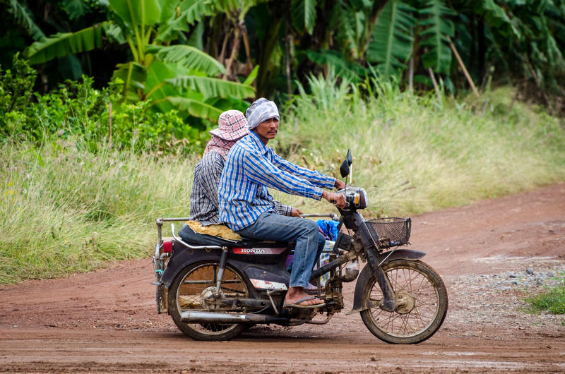 Thai men riding a cross motorbike. In Central Thailand royalty free stock photos