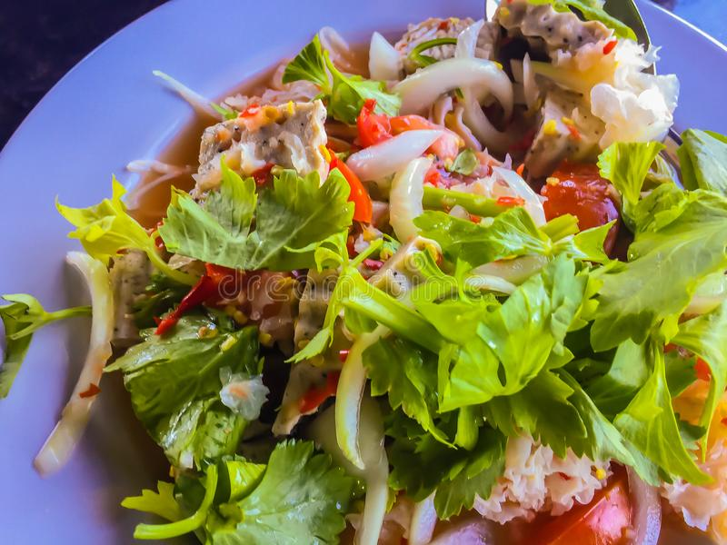Thai mixed sour and spicy seafood salad on the plate. royalty free stock photography