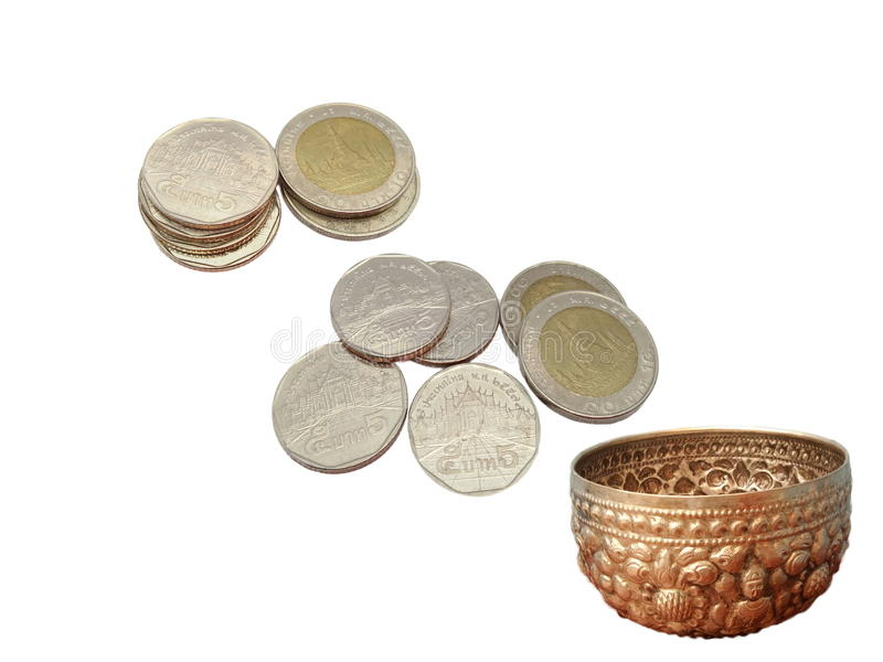 Thai money coins and silver Thai stencil bowl royalty free stock image