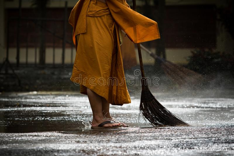 Thai monk daily cleaning in buddist temple stock photo