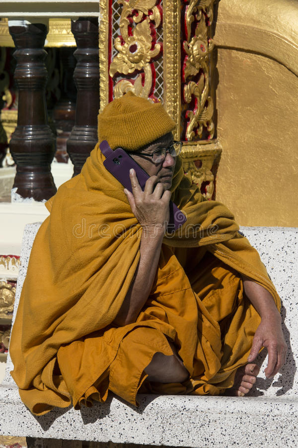 Thai Buddhist Monk using Cellphone - Thailand royalty free stock photography