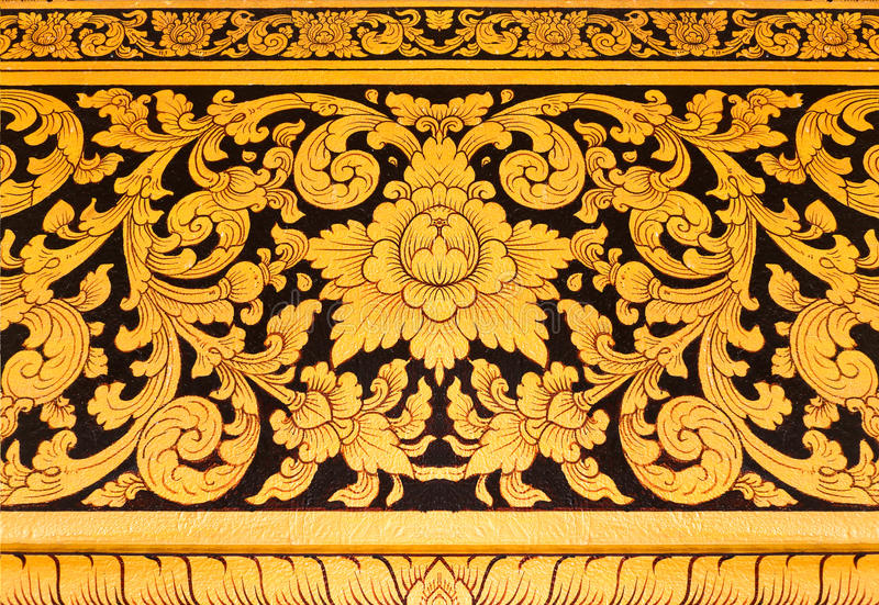 Thai mural in temple thailand gold painting on black background royalty free stock photography