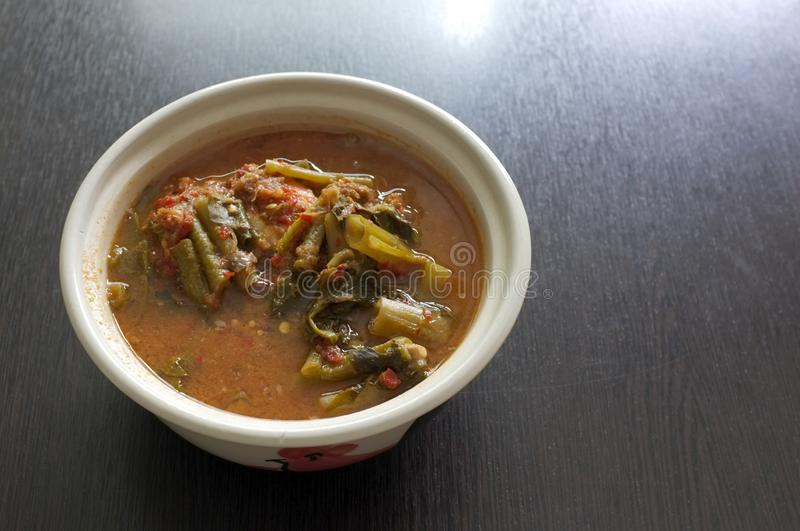 THAI name is Kaeng Som hot or sour curry mixed vegetables and shrimp.  stock photo