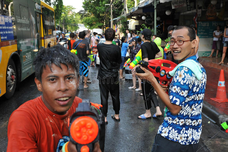 Thai New Year Revellers Enjoy a Water Fight royalty free stock photo