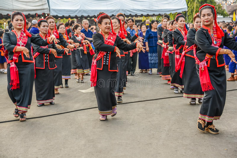 Thai northeastern traditional dance by senior women in parade. NAKORN PHANOM, THAILAND - FEBRUARY 14, 2015 : Thai northeastern dance by senior women in parade in royalty free stock photo