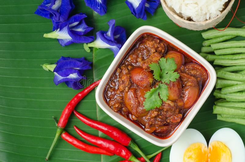 Thai Northern Style Pork and Tomato Chili Relish with sticky rice and vegetables on banana leaf, Nam Prik Aawng, Nam Prik Ong, Br. Uschetta fried with pork, oil royalty free stock photos