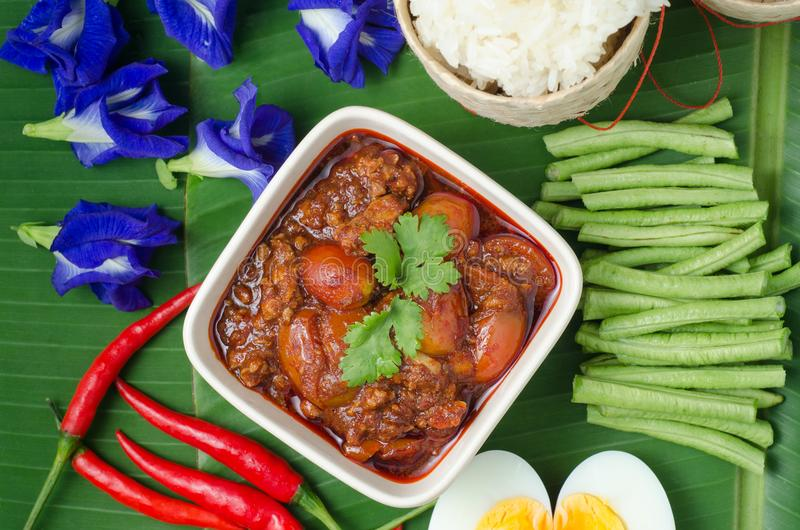 Thai Northern Style Pork and Tomato Chili Relish with sticky rice and vegetables on banana leaf, Nam Prik Aawng, Nam Prik Ong, Br. Uschetta fried with pork, oil stock image