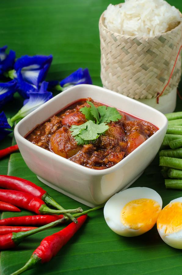Thai Northern Style Pork and Tomato Chili Relish with sticky rice and vegetables on banana leaf, Nam Prik Aawng, Nam Prik Ong, Br stock photos