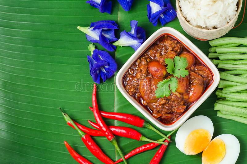Thai Northern Style Pork and Tomato Chili Relish with sticky rice and vegetables on banana leaf, Nam Prik Aawng, Nam Prik Ong, Br. Uschetta fried with pork, oil stock images