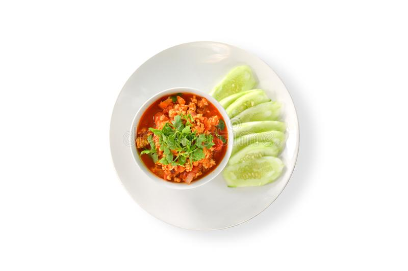 Thai Northern Style Pork and Tomato Relish in white bowl served with cucumber sliced isolated on white background, clipping path. Hot and spicy dipping stock photos