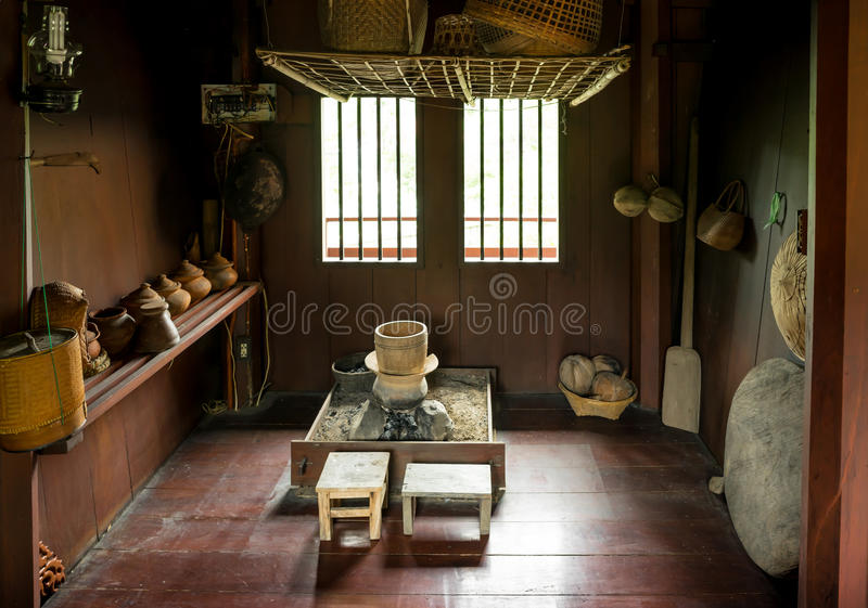 Thai old kitchen. Old style of Thai kitchen inside the wooden house of northern Thai people royalty free stock images