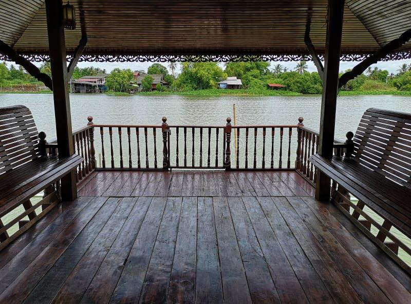 Thai old style Waterfront pavilion , Nakhon Chai Si River Thailand. Thai old style Waterfront wood pavilion , Nakhon Chai Si River Thailand stock photography