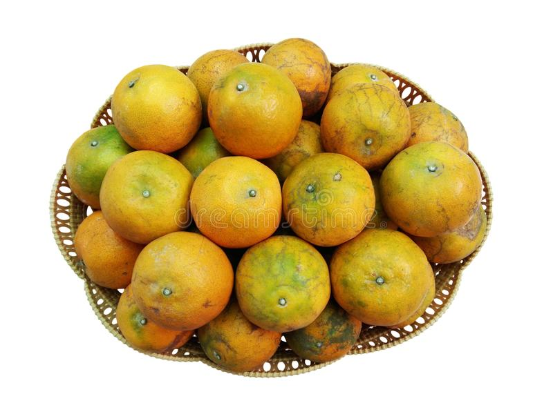 Thai oranges in wooden wicker basket royalty free stock photos