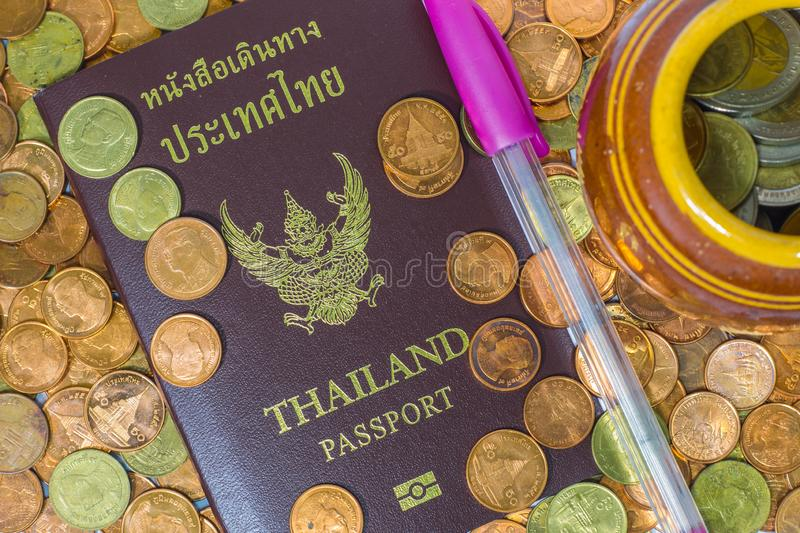 Thai passport on a pile of coins royalty free stock photography
