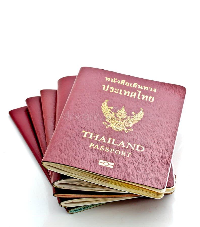 Thai passports on white background. Thai passports stacking on white background royalty free stock photos