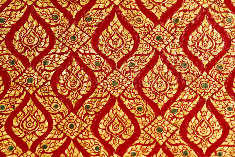 Thai pattern. Gold on red stock image