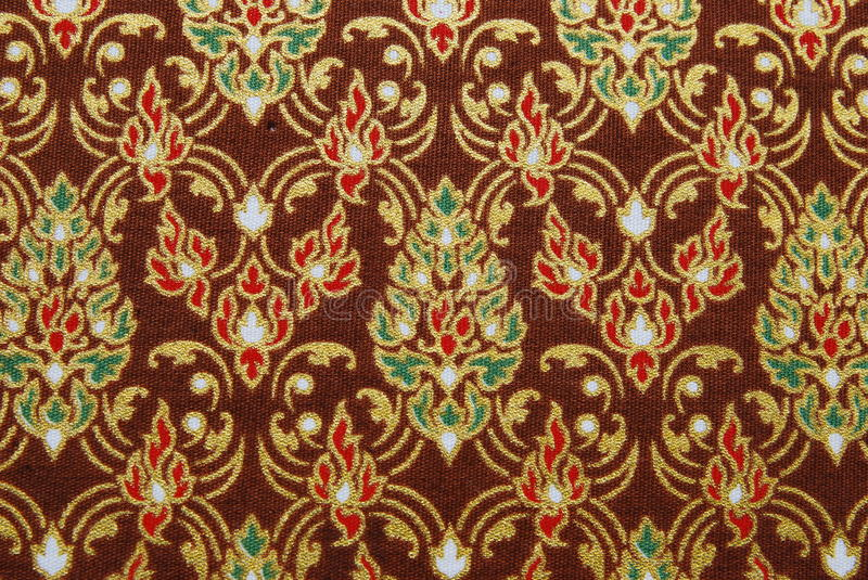 Thai pattern. The beautiful Thai pattern on a cloth stock image