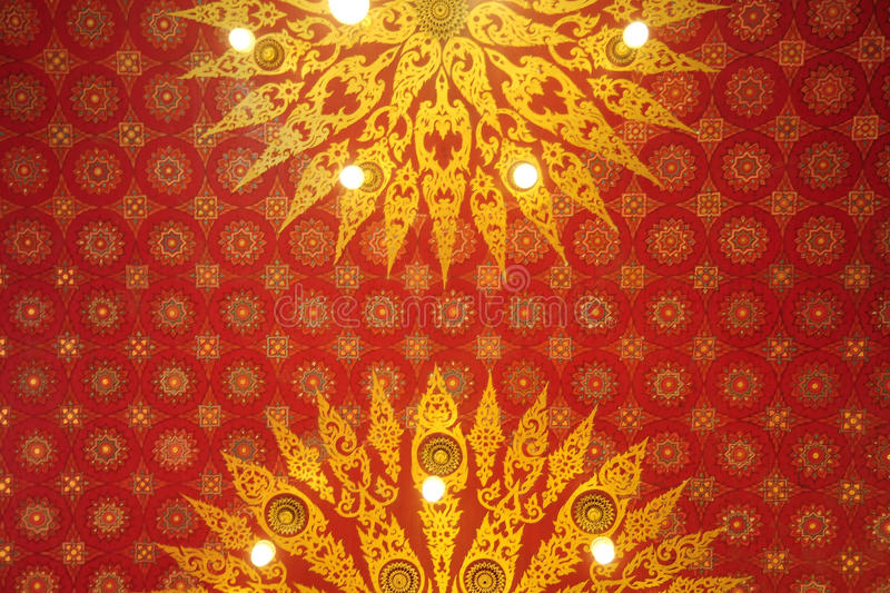 Thai pattern in temple. A Thai art pattern from temple ceiling stock photo