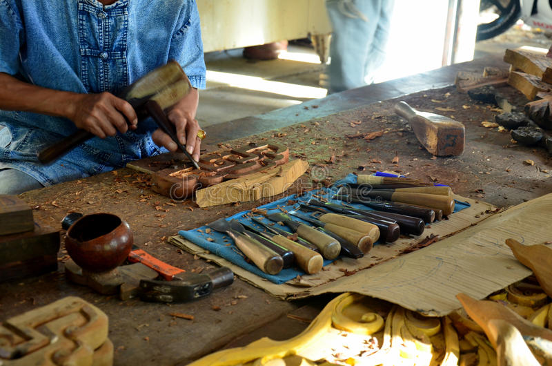 Thai people carving traditional thai art wood figure. For show traveller royalty free stock photography