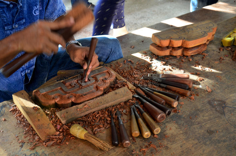 Thai people carving traditional thai art wood figure. For show traveller royalty free stock image