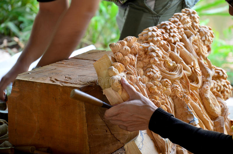 Thai people carving traditional thai art wood figure. For show traveller royalty free stock photos