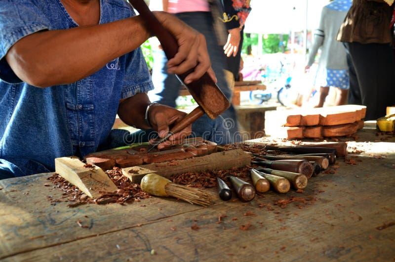 Thai people carving traditional thai art wood figure. For show traveller at Ancient City Muang Boran Samutprakarn in Samutprakarn, Thailand royalty free stock image