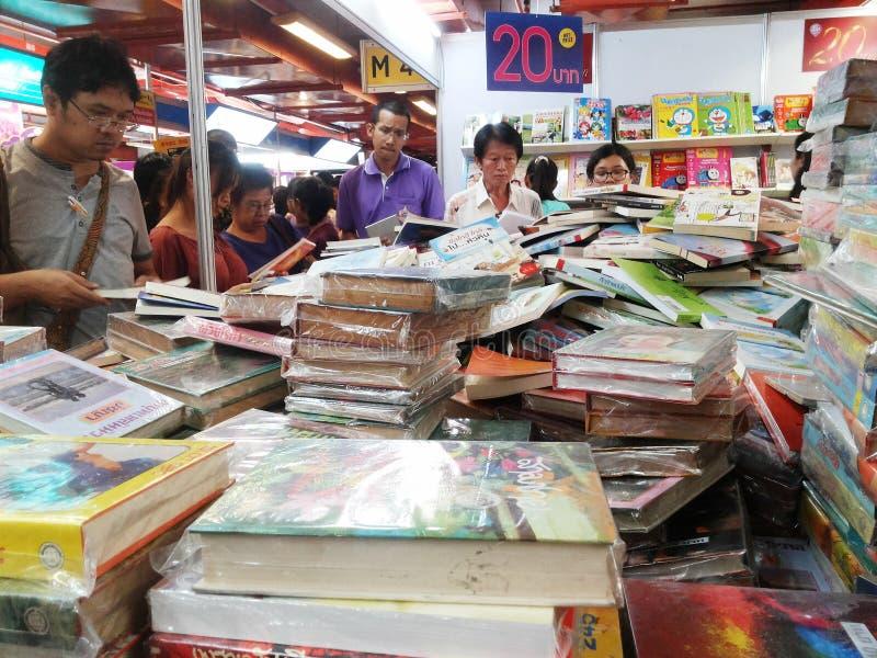 Thai people choosing book at the book fair. Thai people choosing cheap sale price book at the 43rd National Book Fair and 13th Bangkok International Book Fair royalty free stock photography