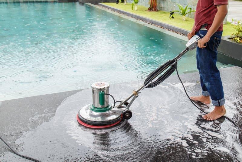 Thai people cleaning black granite floor with machine and chemical. Thai people cleaning black granite floor stock photo