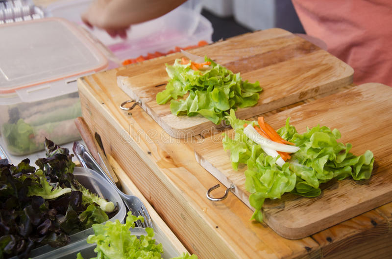Thai people cooking fresh vegetable organic salad rice sheet rolls or spring roll recipe. For sale at organic & street market royalty free stock images