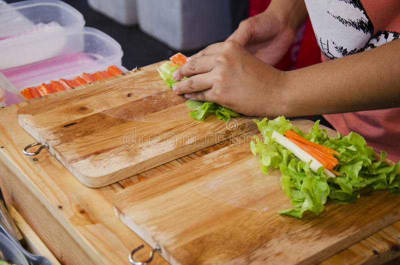Thai people cooking fresh vegetable organic salad rice sheet rolls or spring roll recipe. For sale at organic & street market royalty free stock photo