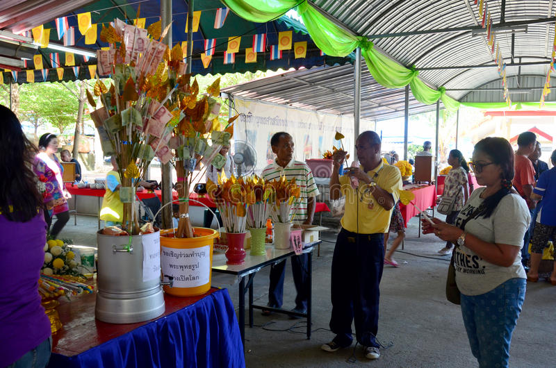 Thai people donate money in Kathin Ceremony. Thai people cooking give food for free to people in Kathin Ceremony at temple on November 21, 2015 in Nonthaburi stock photography