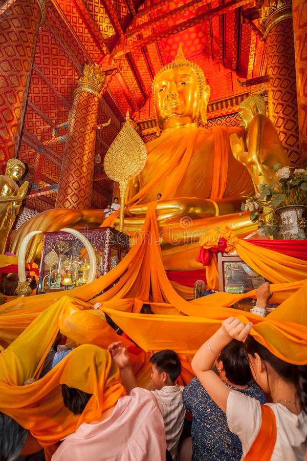 Thai people dedicate the yellow robe. AYUTTHAYA,THAILAND- MARCH 26:Thai people dedicate the yellow robe to Luang Por To and cover it on their head to make more stock images