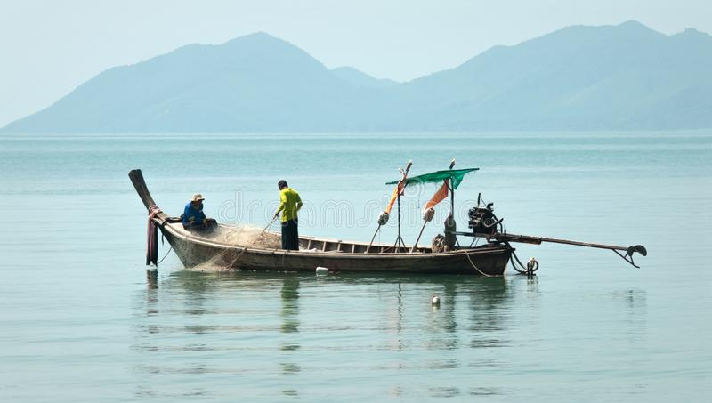 Thai people and fishing boats in the sea of Thailand stock photos